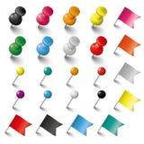 Banderas y tachuelas de los pernos coloreados fijadas Imágenes de archivo libres de regalías