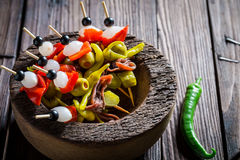 Banderillas with fresh ingredients for spanish corrida. On wooden table Stock Photos