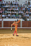 Banderillero, the torero who, on foot, places the darts in the bull. The banderillas is Brightly-coloured darts placed in the bull Stock Images