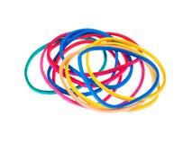 Bandes élastiques multicolores au-dessus d'un fond blanc Image stock