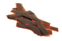 Bandes de film au-dessus de blanc Photos stock