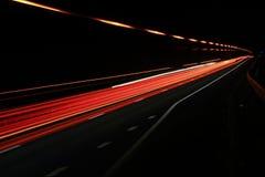 Bandes de lumière colorées sur la route Images libres de droits