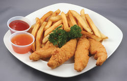 Bandes et fritures de poulet combinées Images libres de droits