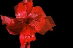 Bandes rouges de fête de cadeau Image stock