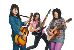bandgitarrister vaggar kvinnor Arkivfoton