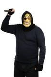 Bandido enmascarado que agita el cuchillo grande Imágenes de archivo libres de regalías
