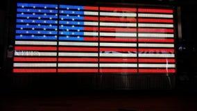 Bandiera americana alle luci Immagine Stock