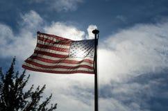 Bandiera americana che ondeggia in vento Fotografia Stock