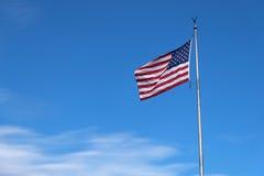 Bandiera americana che soffia il vento Fotografie Stock Libere da Diritti