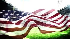 Bandiera americana che soffia in stadio di football americano stock footage