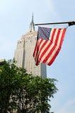 bandiera americana con la priorità bassa della condizione dell'impero immagine stock libera da diritti