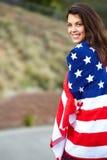Bandiera americana d'uso della donna Fotografia Stock
