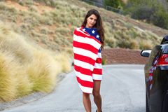Bandiera americana d'uso della donna Immagine Stock