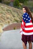 Bandiera americana d'uso della donna Fotografie Stock