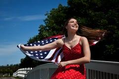 Bandiera americana della donna Fotografie Stock