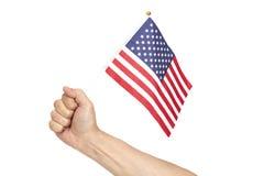 Bandiera americana della holding della mano Fotografia Stock