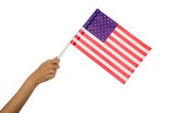 Bandiera americana della holding della mano Fotografie Stock Libere da Diritti