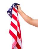 Bandiera americana della tenuta della mano isolata Immagine Stock