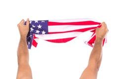 Bandiera americana della tenuta della mano isolata Fotografie Stock Libere da Diritti