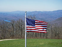 Bandiera americana e montagne Fotografie Stock