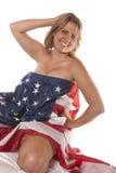 Bandiera americana nuda implicita della giovane donna Fotografia Stock