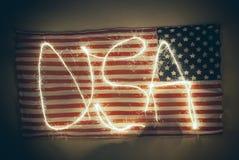 Bandiera americana stagionata con la parola U.S.A. scritto sopra Fotografie Stock Libere da Diritti