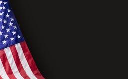 Bandiera americana su fondo nero con lo spazio della copia Fotografia Stock
