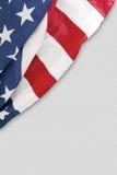 Bandiera americana su priorità bassa bianca Fotografia Stock