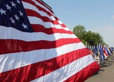 Bandiera americana sulla parata Fotografie Stock Libere da Diritti