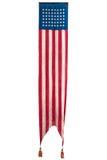 Annata lunga che appende bandiera cerimoniale americana isolata su bianco Immagini Stock Libere da Diritti