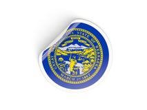 Bandiera autoadesivo rotondo del Nebraska, stato USA Fotografia Stock