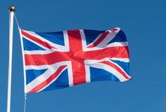 Bandiera BRITANNICA del sindacato della Gran Bretagna che soffia nel vento Fotografia Stock