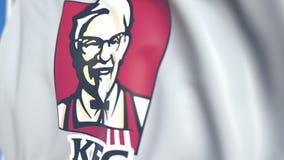 Bandiera d'ondeggiamento con il logo del Kentucky Fried Chicken KFC, primo piano Animazione loopable editoriale 3D illustrazione di stock
