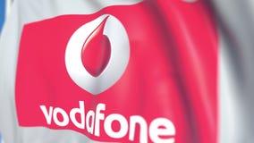 Bandiera d'ondeggiamento con il logo del plc di Vodafone, primo piano Animazione loopable editoriale 3D illustrazione di stock