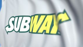 Bandiera d'ondeggiamento con il logo del sottopassaggio, primo piano Animazione loopable editoriale 3D illustrazione di stock