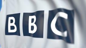 Bandiera d'ondeggiamento con il logo di BBC, primo piano Animazione loopable editoriale 3D archivi video