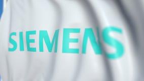Bandiera d'ondeggiamento con il logo di Siemens Ag, primo piano Animazione loopable editoriale 3D video d archivio