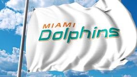 Bandiera d'ondeggiamento con il logo professionale del gruppo di Miami Dolphins clip dell'editoriale 4K illustrazione vettoriale