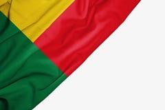 Bandiera del Benin di tessuto con copyspace per il vostro testo su fondo bianco illustrazione vettoriale