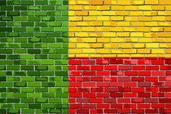 Bandiera del Benin su un muro di mattoni Illustrazione Vettoriale