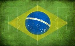 Bandiera del Brasile sul campo Fotografia Stock