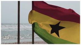 Bandiera del Ghana sulla spiaggia di Labadi della spiaggia a Accra fotografie stock libere da diritti