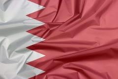 Bandiera del tessuto del Bahrain Piega del fondo del Bahrein della bandiera fotografia stock libera da diritti