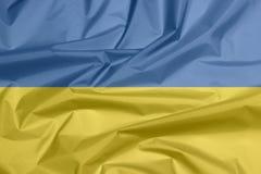 Bandiera del tessuto dell'Ucraina Piega del fondo ucraino della bandiera immagini stock