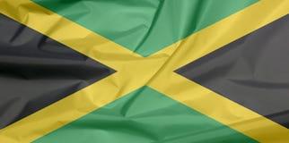 Bandiera del tessuto della Giamaica Piega del fondo giamaicano della bandiera illustrazione di stock