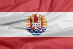Bandiera del tessuto della Polinesia francese Piega del fondo della bandiera di Polinesia francese fotografia stock