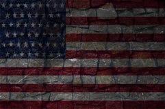 Bandiera dell'America su una parete di pietra fotografia stock