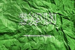 Bandiera dell'Arabia Saudita dipinta su fondo di carta sgualcito Fotografie Stock