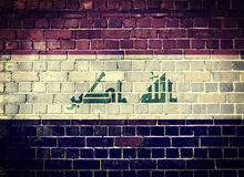 Bandiera dell'Irak di lerciume su un muro di mattoni Immagine Stock Libera da Diritti