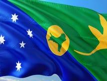Bandiera dell'isola di Natale che ondeggia nel vento contro il cielo blu profondo Tessuto di alta qualit? fotografia stock libera da diritti